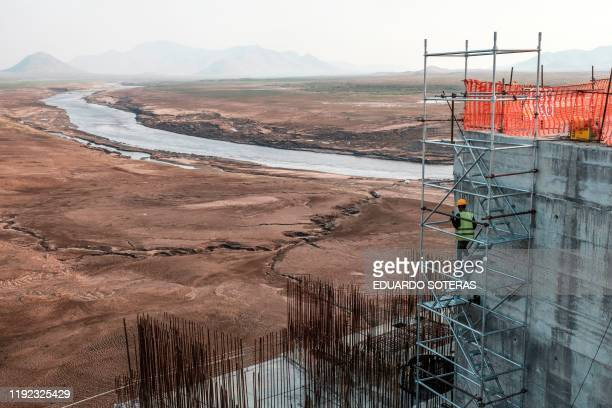A worker goes down a construction ladder at the Grand Ethiopian Renaissance Dam near Guba in Ethiopia on December 26 2019 The Grand Ethiopian...
