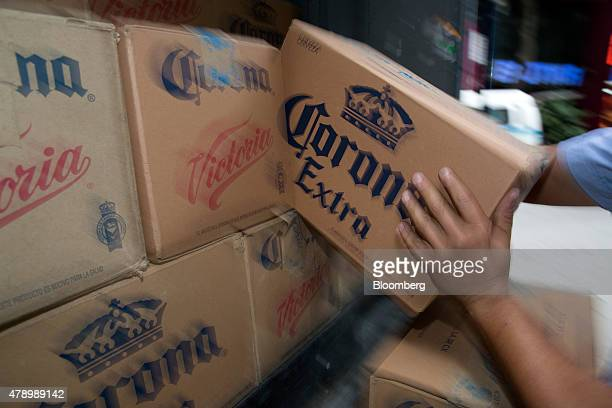A worker grabs a case of Constellation Brands Inc Corona beer during a delivery in the Zona Rosa neighborhood in Mexico City Mexico on Wednesday June...
