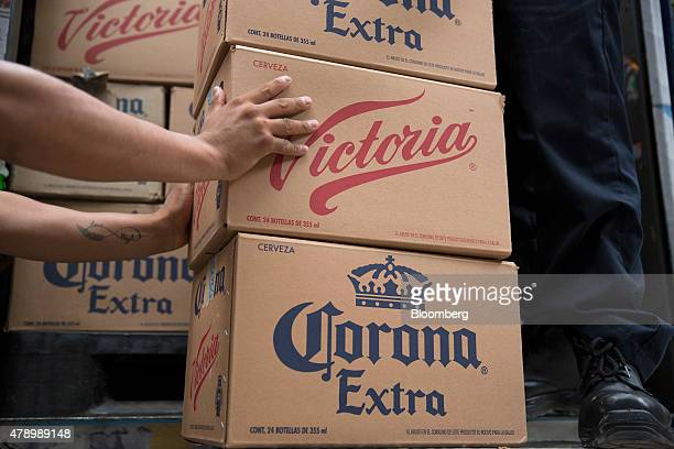 A worker grabs a case of Constellation Brands Inc Victoria beer during a delivery in the Zona Rosa neighborhood in Mexico City Mexico on Wednesday...