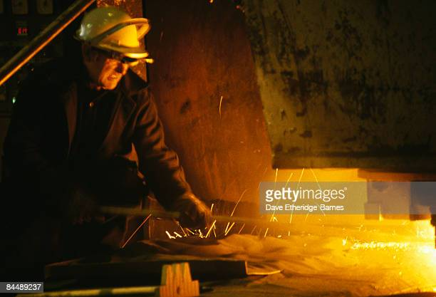 A worker grimaces while operating in hostile conditions during steel production at Llanwern Steel Works near Newport in Gwent South Wales on October...