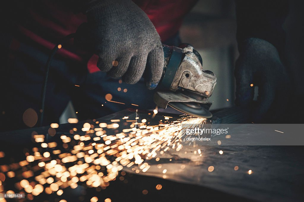 Worker grinding metal close up shot : Stock Photo