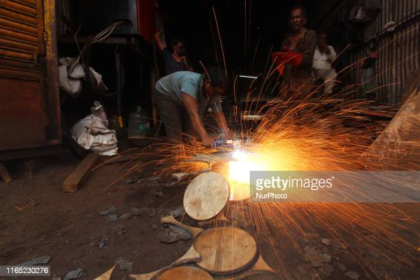 A worker grinds metal at a workshop in Mumbai India on 31 August 2019
