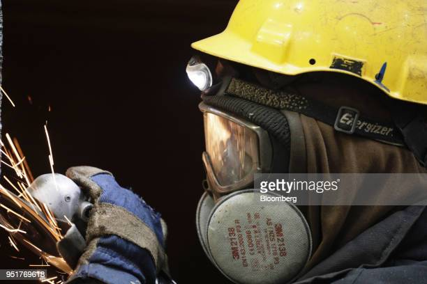 Worker grinds steel for ship sections during welding operations at the GSG Towers Sp. Z o.o. Factory, a unit of the Gdansk Shipyard Group, in Gdansk,...