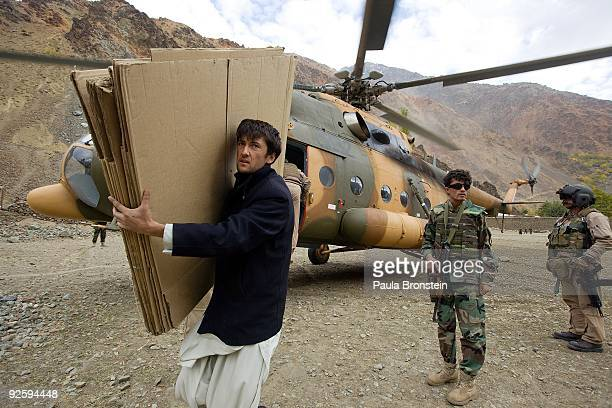 IEC worker Hamayoon Bahman unloads election material from a helicopter in the remote village of Kofab in Badakdshan province along the Tajikistan...