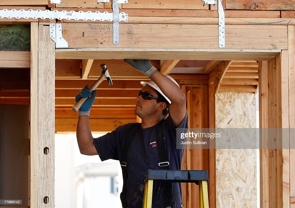 A worker hammers while building a new home at a housing development September 27, 2007 in Richmond, California.Tthe Commerce Department reported today that sales of new homes fell 8.3 percent in August, bringing sales to an annual rate of 795,000 units, the lowest level since June 2007.