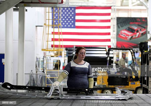 A worker handle parts for Fiat Chrysler Automobiles as they come off the press at the FCA Sterling Stamping Plant August 26 2016 in Sterling Heights...