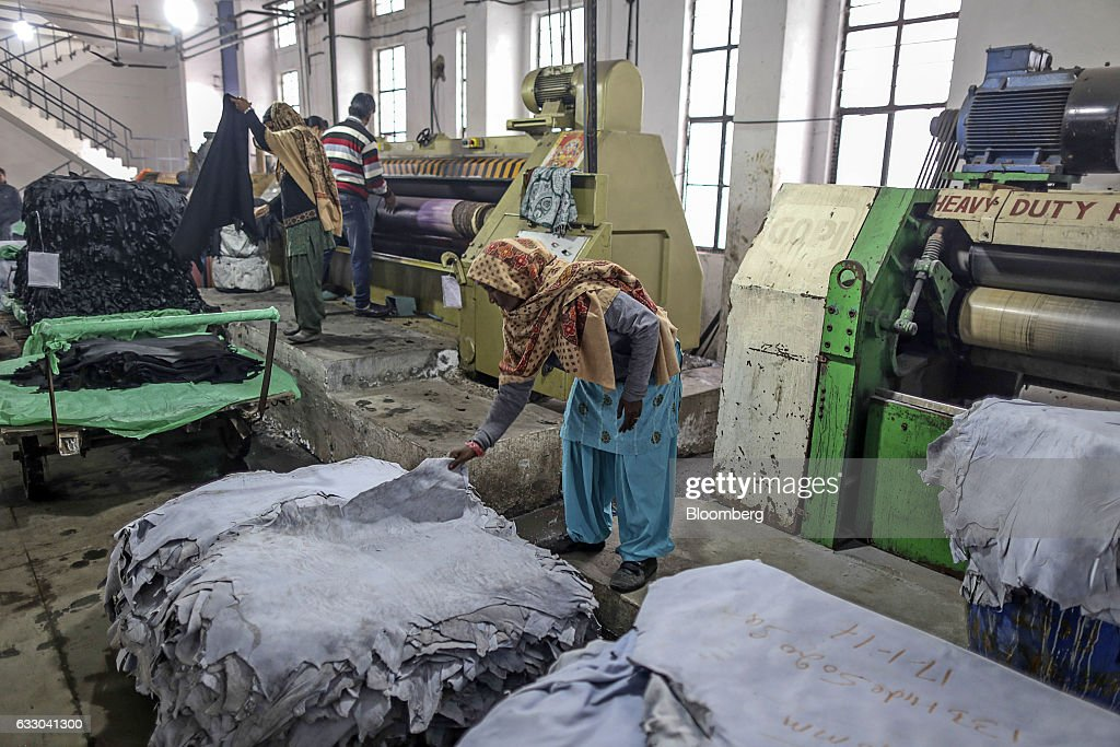A worker handles a sheet of leather at the Jalandhar Leather Pvt tannery in Jalandhar Punjab India on Saturday Jan 21 2017 India`s 51 million micro...
