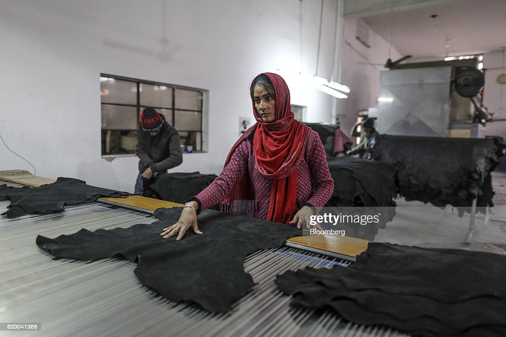 A worker handles a sheet of processed leather at the Jalandhar Leather Pvt tannery in Jalandhar Punjab India on Saturday Jan 21 2017 India`s 51...