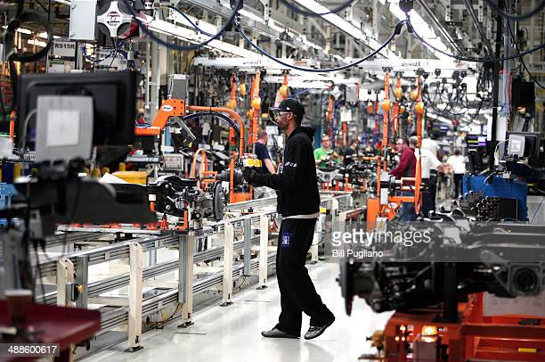 A worker handles a suspension for a 2014 Jeep Cherokee at the Chrysler Toledo North Assembly Plant Jeep May 7 2014 in Toledo Ohio Fiat Chrysler...