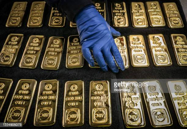A worker handles ABC Bullion one kilogram gold bars at the ABC Refinery smelter in Sydney New South Wales Australia on Thursday July 2 2020 Western...