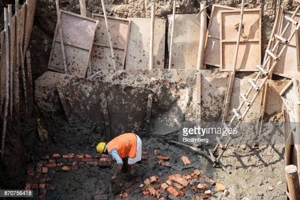 A worker handles bricks at a construction site in Kathmandu Nepal on Wednesday Nov 1 2017 India and China have often jostled for influence in Nepal a...