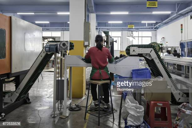 A worker handles casters at a factory operated by the Guangdong Shiyi Furniture Co in Foshan China on Tuesday Feb 28 2017 Startup EDeodar a...