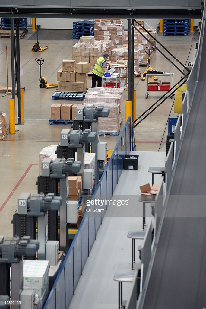 A worker handles items near boxes in the giant semi-automated distribution centre where the company's partners process the online orders for the John Lewis department store on January 3, 2013 in Milton Keynes, England. John Lewis has published their sales report for the five weeks prior December 29, 2012 which showed online sales had increased by 44.3 per cent over the same period in 2011. Purchases from their website Johnlewis.com now account for one quarter of all John Lewis business.