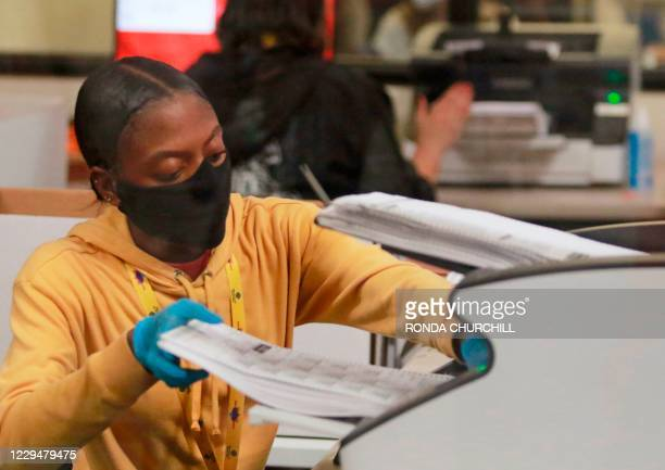 Worker handles official ballots at the Clark County Election Department on November 5 in North Las Vegas.