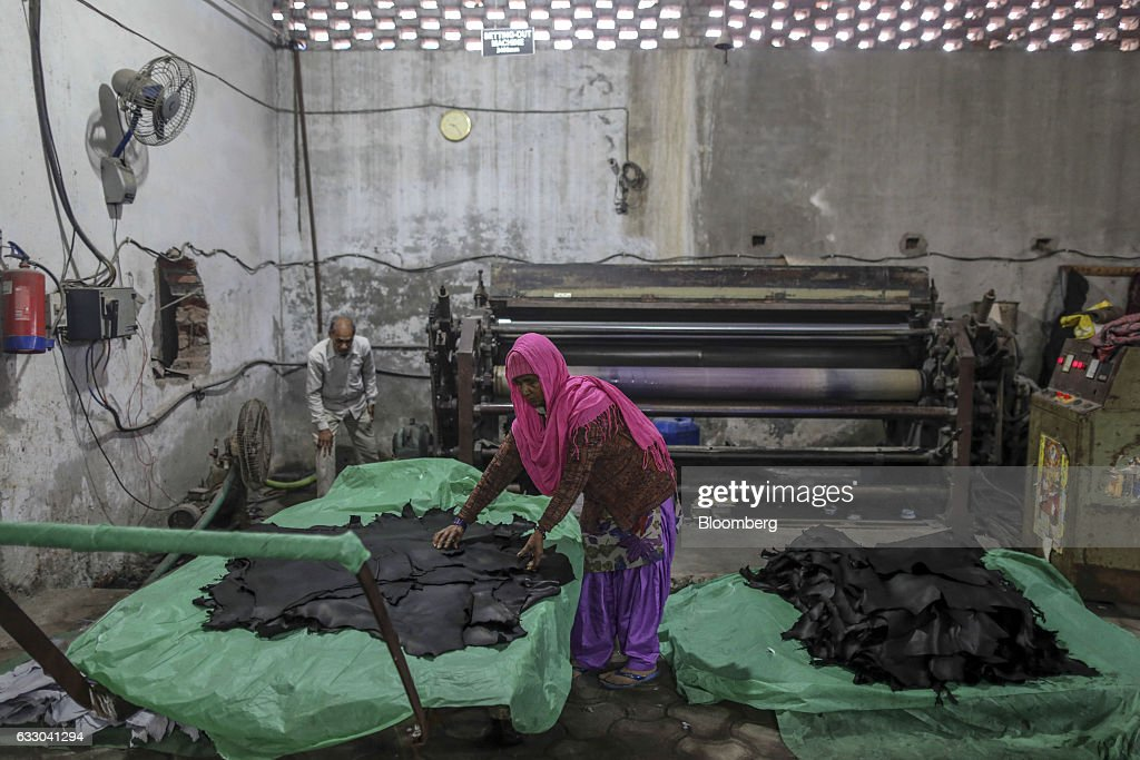 A worker handles sheets of dyed leather at the Jalandhar Leather Pvt tannery in Jalandhar Punjab India on Saturday Jan 21 2017 India`s 51 million...