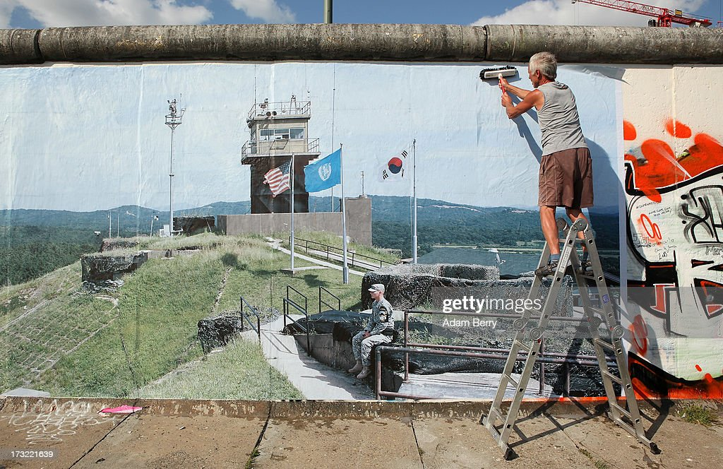 'Wall on Wall' Exhibition Shows Global Separation Borders On Former Berlin Wall : News Photo