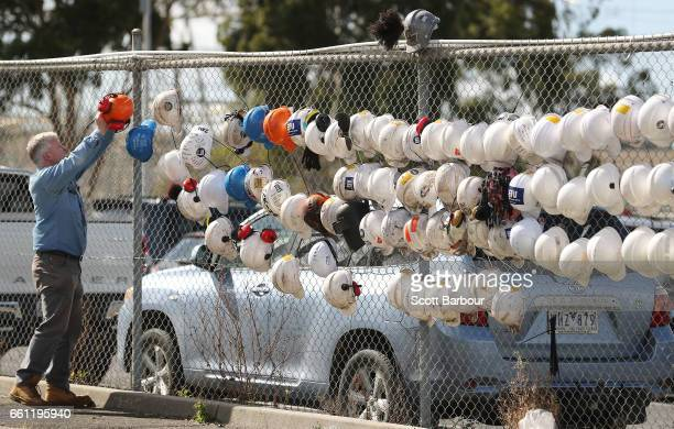 A worker hangs his hard hat on the fence outside of the Hazelwood Power Station on March 31 2017 in Hazelwood Australia Around 750 workers have been...