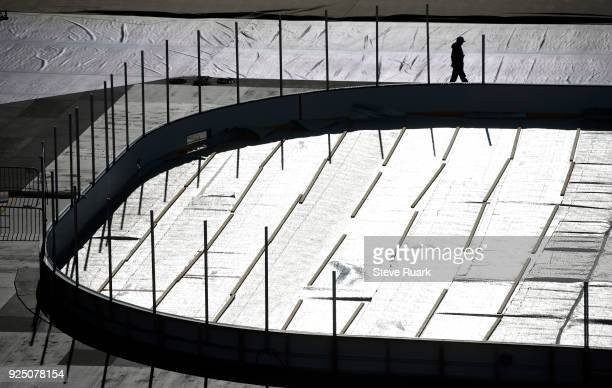 A worker helps prepare NavyMarine Corps Memorial Stadium for the 2018 Coors Light NHL Stadium Series game on February 27 2018 in Annapolis Maryland...