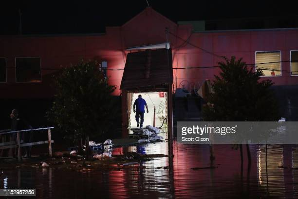 A worker helps to secure a riverboat casino as floodwater from the Mississippi River rises in the downtown area on May 31 2019 in Alton Illinois The...