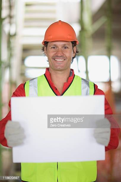 Worker holding an empty sheet of paper