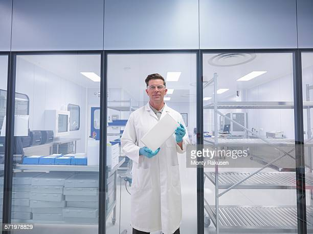Worker holding orthopaedic medical product box outside clean room
