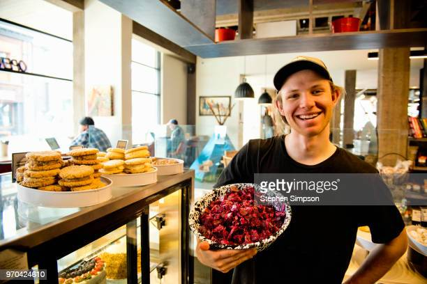 worker holding salad bowl in cafe in montana - small town america stock pictures, royalty-free photos & images