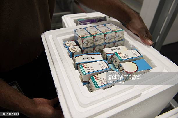 A worker holds a container with refrigerated pharmaceuticals ready to be shipped at a United Parcel Service Inc Healthcare Supply Chain and...