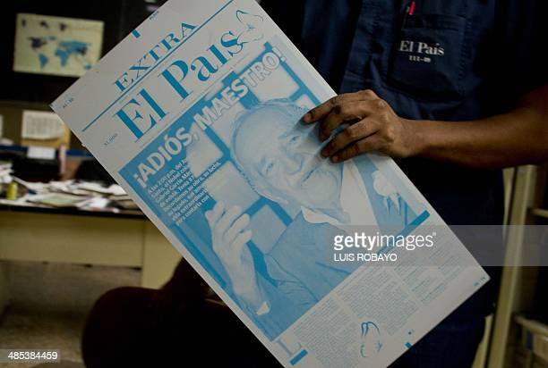 A worker holds a printing plate of a local newspaper whose front page announces the death of Colombian Literature Nobel Prize 1982 laureate Gabriel...