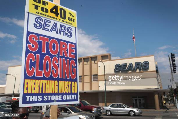 Worker holds a sign announcing a store-closing sale outside the 60-year-old Sears store in the Galewood neighborhood on July 7, 2017 in Chicago,...