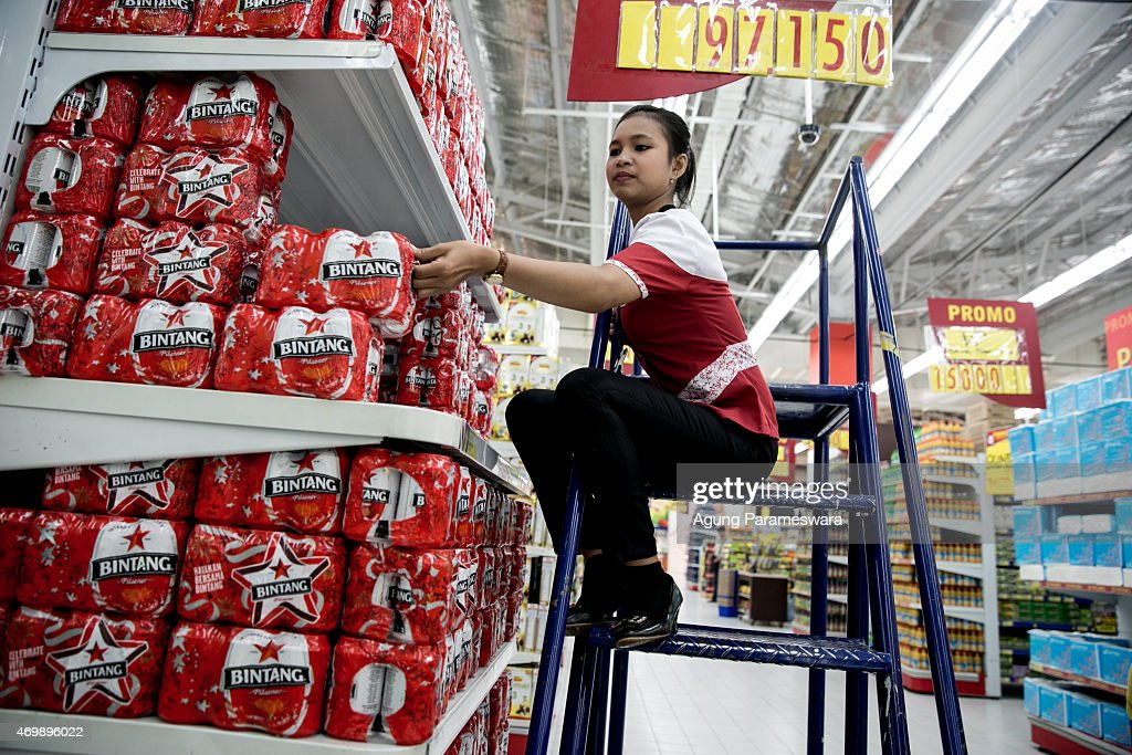 A worker holds up a box of Bintang beer at a Hypermart on April 16, 2015 in Denpasar, Bali, Indonesia. Indonesia, on April 16, banned small retailers from selling beer which is proposed that legislation by two Islamic parties-the Prosperous Justice Party and the United Development Party-that would ban all consumption of alcoholic drinks and bring jail terms of up to two years for offenders in Indonesia, home to the world's largest Muslim population. The regulation states that it is needed to protect public morals and culture and to improve the control and supervision of alcohol production, distribution and sales. There had been particular anxiety about how the ban might affect tourism on the Hindu-majority resort island of Bali. However, Indonesian trade minister Rachmat Gobel, who was shouted at during an ill-tempered meeting with community leaders in Bali last weekend, has now pledged to ease the restrictions on the island to ensure street vendors can still sell beer at the beach.