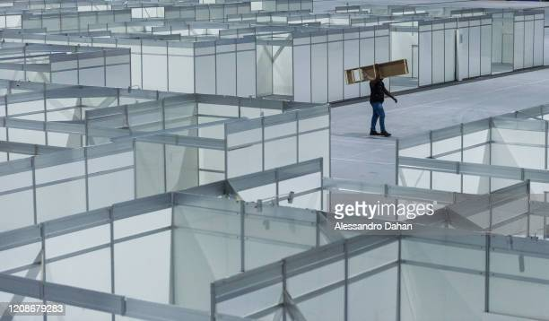 Worker in a field hospital under construction in Riocentro Convention Center on March 30, 2020 in Rio de Janeiro, Brazil. The facility is being set...
