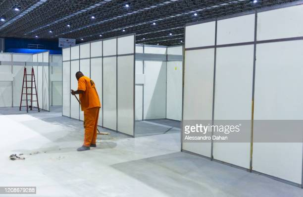 A worker in a field hospital under construction in Riocentro Convention Center on March 30 2020 in Rio de Janeiro Brazil The facility is being set up...