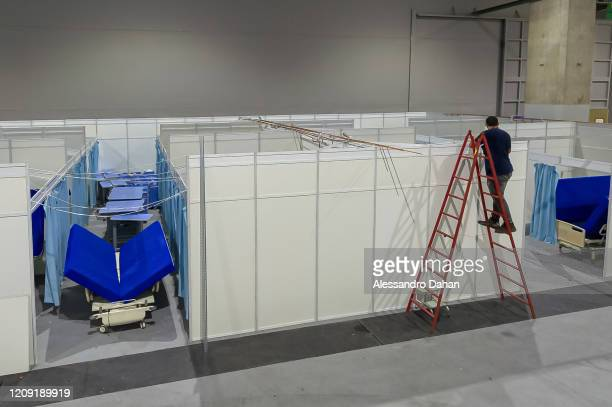 A worker in a field hospital under construction in Riocentro Convention Center on April 05 2020 in Rio de Janeiro Brazil The facility is being set up...