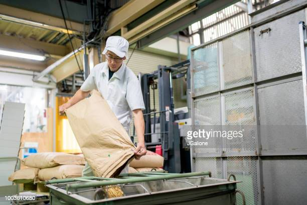 Worker in a food processing factory