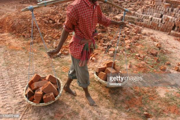 Worker in a West Bengal brick factory India