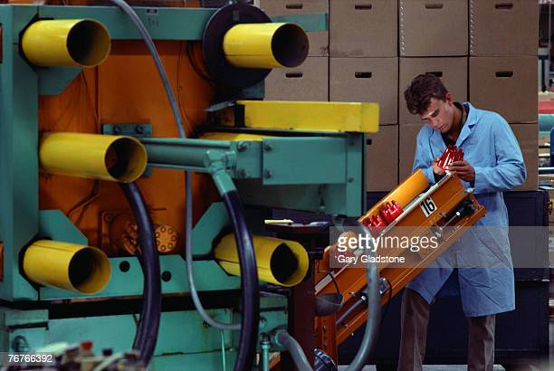 Worker in auto parts manufacturing plant