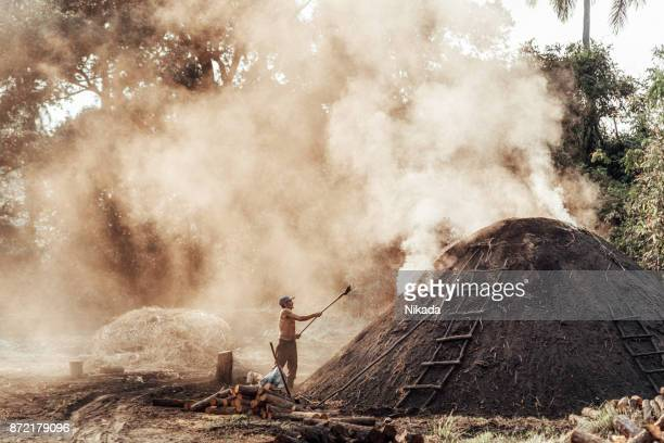 worker in Cuba producing Charcoal