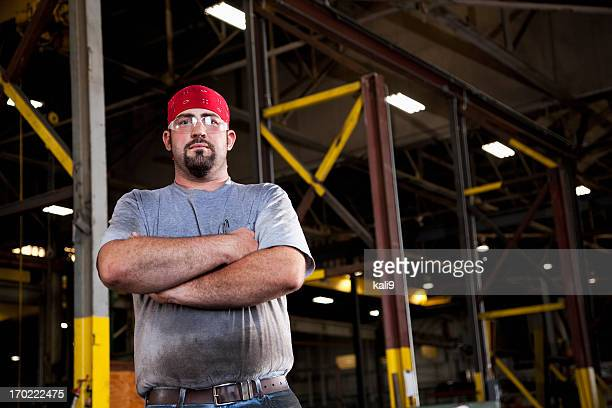 worker in fabrication shop - macho stock pictures, royalty-free photos & images