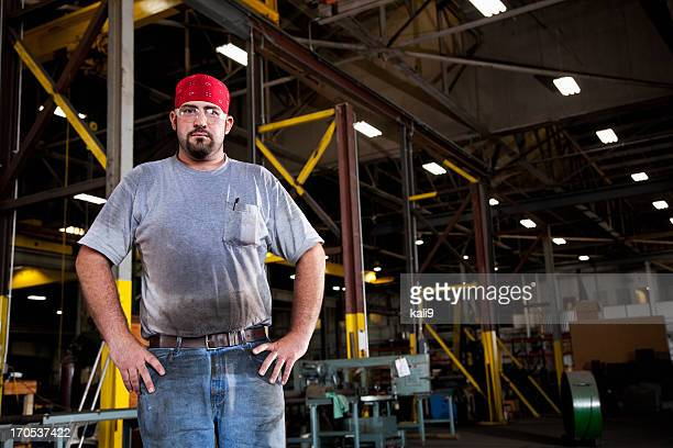 Worker in fabrication shop