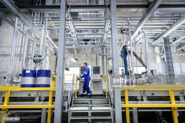 worker in filling station at oil blending factory - drum container stock photos and pictures
