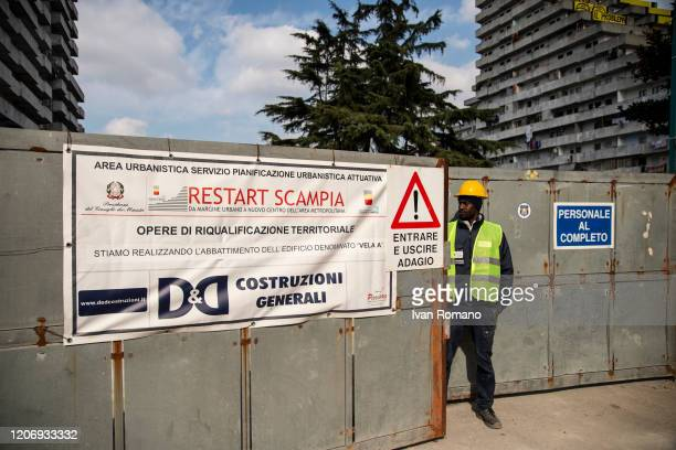 A worker in front of the entrance to the Vela demolition site on February 17 2020 in Naples Italy The Municipality of Naples has announced that...