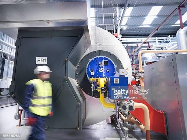 worker in gas fired power station - monty rakusen stock-fotos und bilder