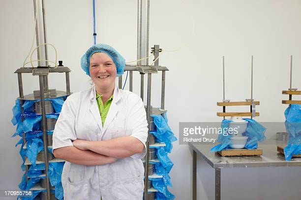 Worker in goats cheese production unit