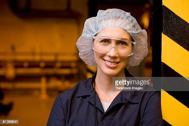 Worker in goggles and hair net