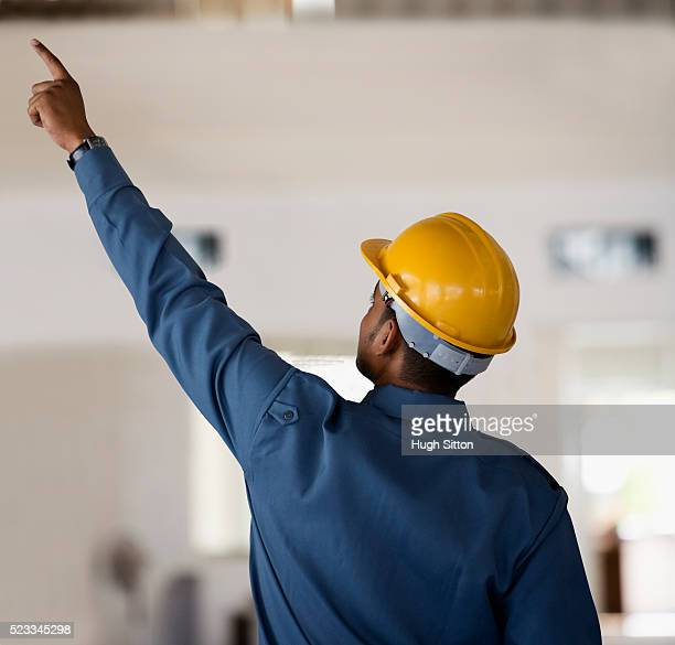 worker in hard hat pointing - hugh sitton bildbanksfoton och bilder