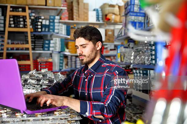 Worker in hardware store