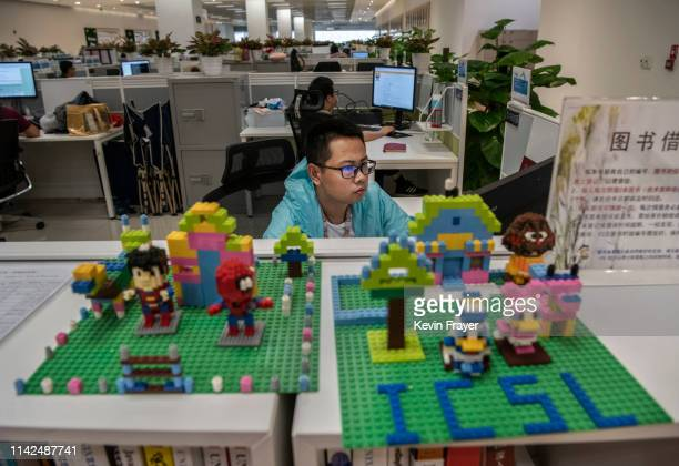 A worker in Huawei's Cyber Security Lab works on his computer at the company's production campus on April 25 2019 in Dongguan near Shenzhen China...