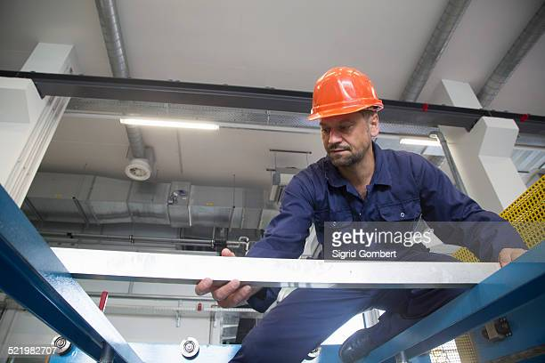 worker in industrial plant - sigrid gombert stock pictures, royalty-free photos & images