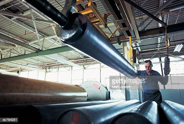 worker in linoleum factory - リノリウム ストックフォトと画像