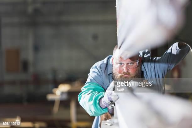 Worker in metal fabrication plant